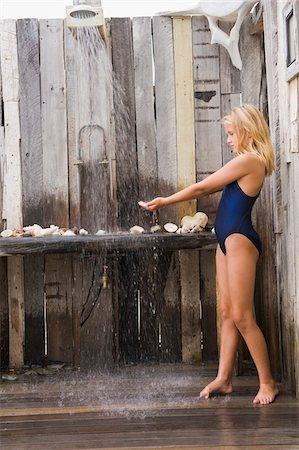 Girl under a beach shower Stock Photo - Premium Royalty-Free, Code: 6108-05874300
