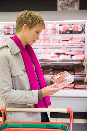 Woman shopping in a supermarket Stock Photo - Premium Royalty-Free, Code: 6108-05874433