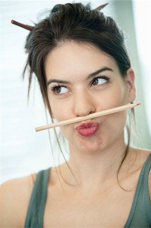 pucker - Woman balancing a pencil on lip Stock Photo - Premium Royalty-Free, Code: 6108-05874798