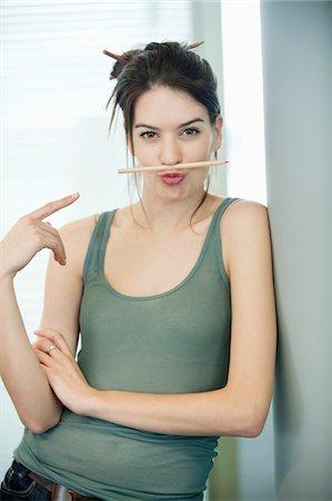 pucker - Woman balancing a pencil on lip Stock Photo - Premium Royalty-Free, Code: 6108-05874799