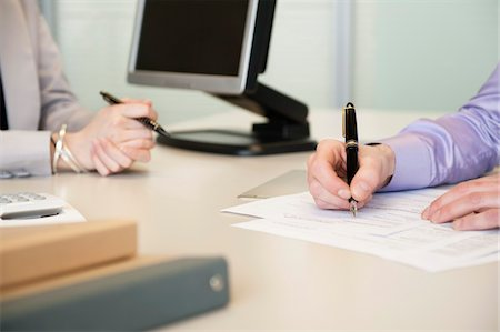 form - Man signing documents Stock Photo - Premium Royalty-Free, Code: 6108-05874733