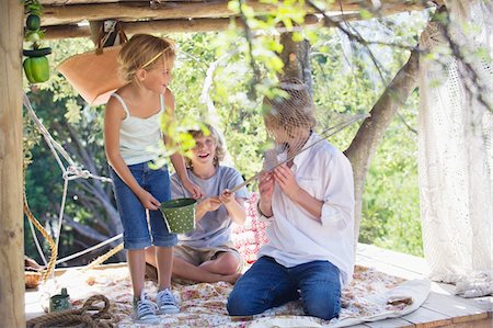 stick - Children playing in tree house Stock Photo - Premium Royalty-Free, Code: 6108-05874976