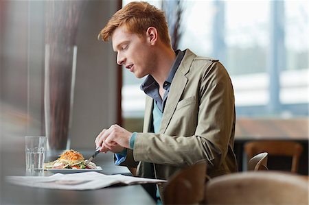 Man sitting in a restaurant taking lunch Stock Photo - Premium Royalty-Free, Code: 6108-06166041