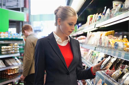 selecting - Couple shopping in a supermarket Stock Photo - Premium Royalty-Free, Code: 6108-06166062