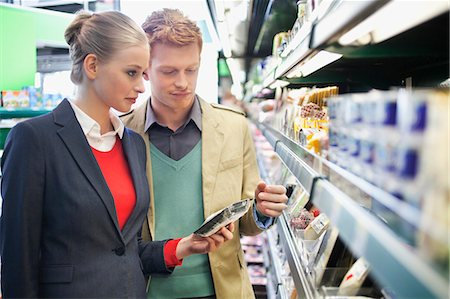 selecting - Couple shopping in a supermarket Stock Photo - Premium Royalty-Free, Code: 6108-06166025