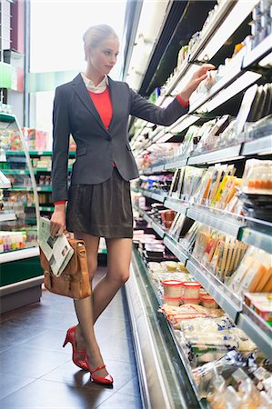 Woman shopping in a supermarket Stock Photo - Premium Royalty-Free, Code: 6108-06166154