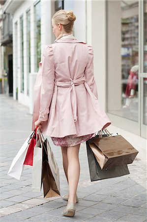 Woman carrying shopping bags Stock Photo - Premium Royalty-Free, Code: 6108-06166106