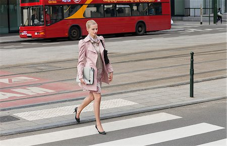 Businesswoman crossing the road Stock Photo - Premium Royalty-Free, Code: 6108-06166111