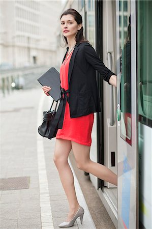 Woman exiting from a bus Stock Photo - Premium Royalty-Free, Code: 6108-06166132