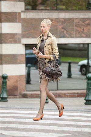 Businesswoman crossing the road Stock Photo - Premium Royalty-Free, Code: 6108-06166134