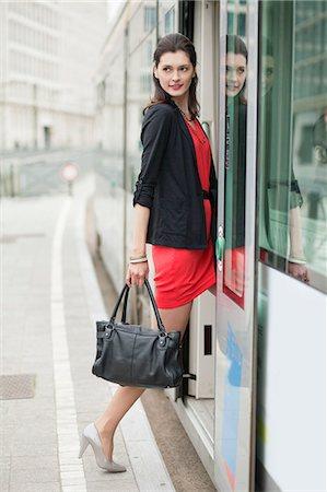 Woman boarding a bus Stock Photo - Premium Royalty-Free, Code: 6108-06166135