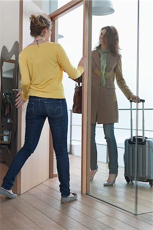 Woman welcoming her friend at doorway Stock Photo - Premium Royalty-Free, Code: 6108-06166365