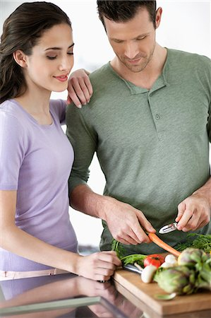 Couple cooking in the kitchen Stock Photo - Premium Royalty-Free, Code: 6108-06166397