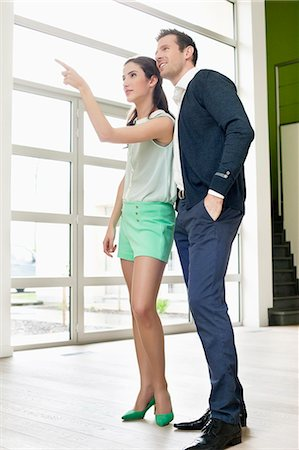 Couple looking for a new house Stock Photo - Premium Royalty-Free, Code: 6108-06166481