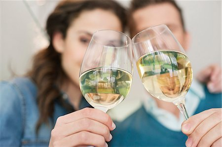 Couple toasting with wine Stock Photo - Premium Royalty-Free, Code: 6108-06166417