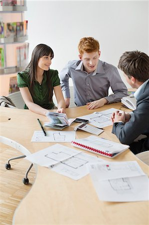 Real estate agent discussing property documents to his clients Stock Photo - Premium Royalty-Free, Code: 6108-06166557