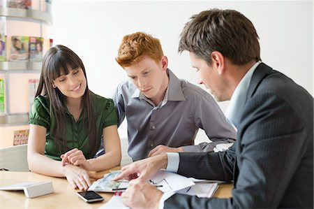 partnership - Real estate agent discussing property documents to his clients Stock Photo - Premium Royalty-Free, Code: 6108-06166567