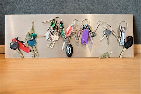 Assorted keys on a metal sheet Stock Photo - Premium Royalty-Free, Code: 6108-06166568