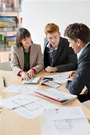 partnership - Real estate agent discussing property documents to his clients Stock Photo - Premium Royalty-Free, Code: 6108-06166526