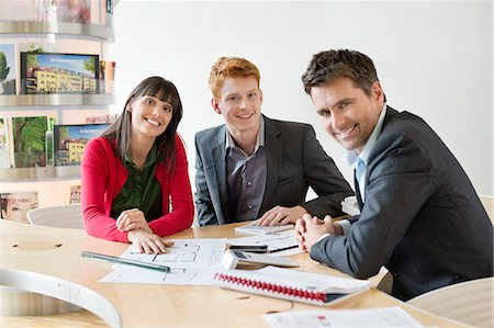 Real estate agent discussing property documents to his clients Stock Photo - Premium Royalty-Free, Code: 6108-06166533
