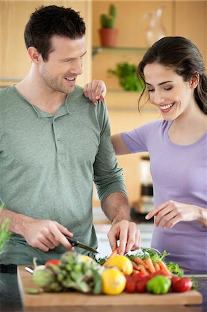 Couple cooking in the kitchen Stock Photo - Premium Royalty-Free, Code: 6108-06166640