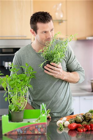 smelly - Man preparing food in the kitchen Stock Photo - Premium Royalty-Free, Code: 6108-06166653