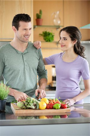 Couple cooking in the kitchen Stock Photo - Premium Royalty-Free, Code: 6108-06166688