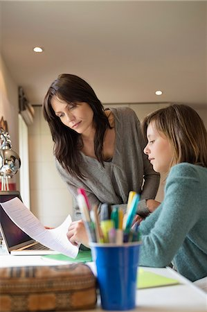 Girl studying with her mother at home Stock Photo - Premium Royalty-Free, Code: 6108-06166629
