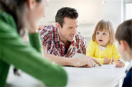 Couple teaching their children at home Stock Photo - Premium Royalty-Free, Code: 6108-06166633
