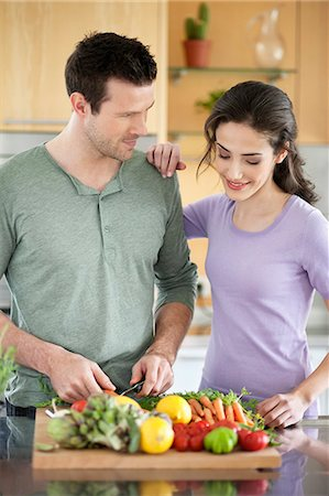 Couple cooking in the kitchen Stock Photo - Premium Royalty-Free, Code: 6108-06166734