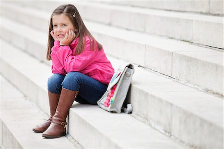 Girl sitting on the steps and thinking Stock Photo - Premium Royalty-Free, Code: 6108-06166844