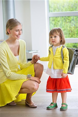 Little girl getting ready for school Stock Photo - Premium Royalty-Free, Code: 6108-06166814