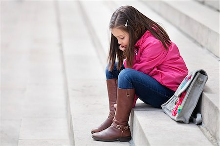 Girl sitting on the steps Stock Photo - Premium Royalty-Free, Code: 6108-06166827