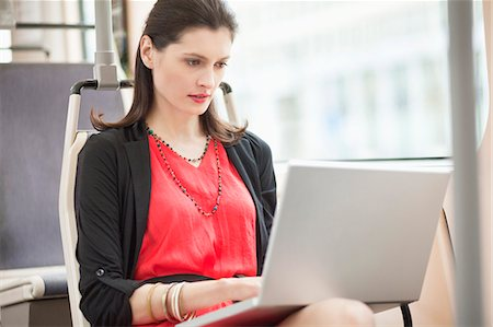 Woman traveling in a bus and using a laptop Stock Photo - Premium Royalty-Free, Code: 6108-06166931