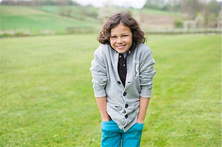 farm and boys - Portrait of a boy smiling in a field Stock Photo - Premium Royalty-Free, Code: 6108-06167042