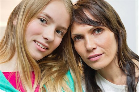 Portrait of mother and daughter smiling Stock Photo - Premium Royalty-Free, Code: 6108-06167187