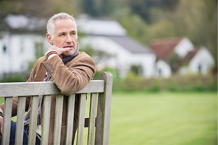 people sitting on bench - Man sitting on a bench and thinking in a park Stock Photo - Premium Royalty-Free, Code: 6108-06167133
