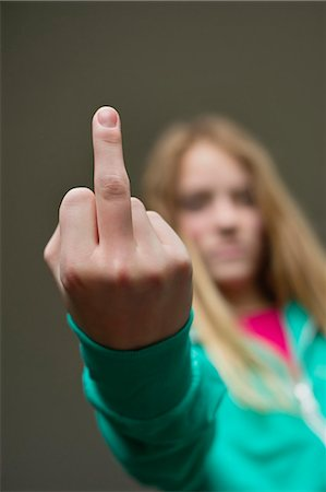 preteens fingering - Girl showing middle finger Stock Photo - Premium Royalty-Free, Code: 6108-06167263