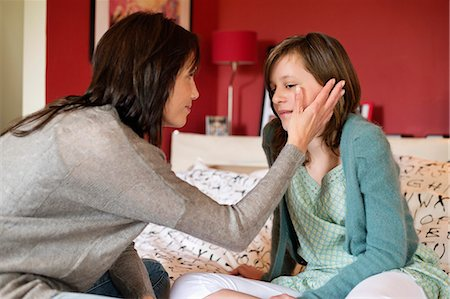 Woman consoling her sad daughter in the bedroom Stock Photo - Premium Royalty-Free, Code: 6108-06167207