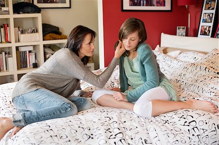 Woman consoling her sad daughter in the bedroom Stock Photo - Premium Royalty-Free, Code: 6108-06167233