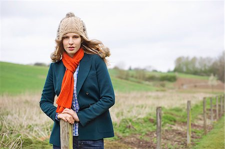 Portrait of a woman standing in a field Stock Photo - Premium Royalty-Free, Code: 6108-06167375