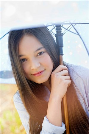 preteen beauty - Portrait of a happy girl holding an umbrella Stock Photo - Premium Royalty-Free, Code: 6108-06167301