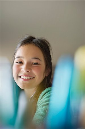 preteen girls faces photo - Portrait of a happy girl smiling Stock Photo - Premium Royalty-Free, Code: 6108-06167310
