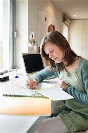 preteen beauty - Girl studying at home Stock Photo - Premium Royalty-Free, Code: 6108-06167311