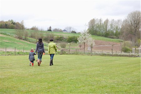 property release - Girl walking with her mother and grandmother in a lawn Stock Photo - Premium Royalty-Free, Code: 6108-06167333
