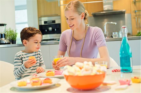 Woman and son at breakfast table Stock Photo - Premium Royalty-Free, Code: 6108-06167401