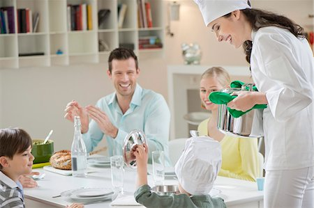 Little boy assisting his mother in serving dinner Stock Photo - Premium Royalty-Free, Code: 6108-06167402