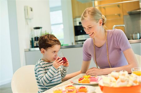 Woman and son at breakfast table Stock Photo - Premium Royalty-Free, Code: 6108-06167417