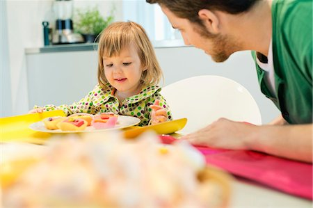 Man and daughter at breakfast table Stock Photo - Premium Royalty-Free, Code: 6108-06167425
