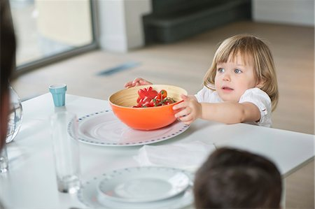 reaching - Little girl placing fruit bowl on dining table Stock Photo - Premium Royalty-Free, Code: 6108-06167429